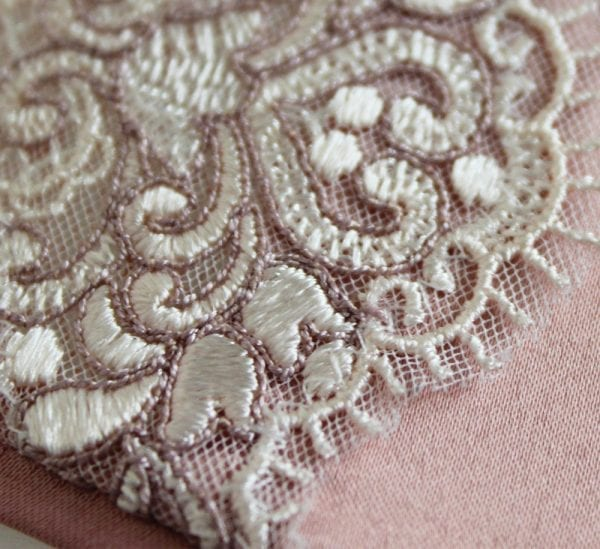 detail shell pink satin with white embroidery