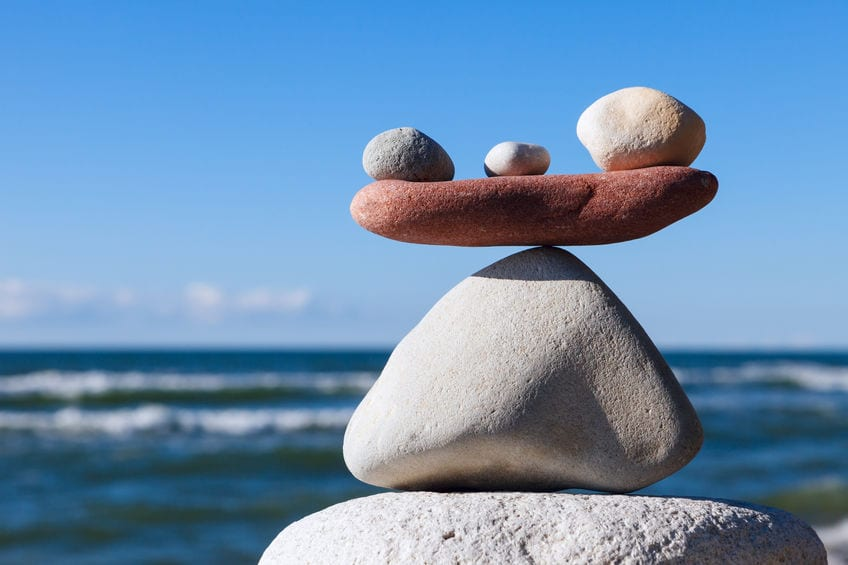 Balancing pebbles on the beach